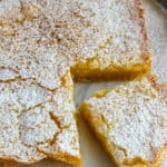 Lemon Squares, on board with corner piece cut.