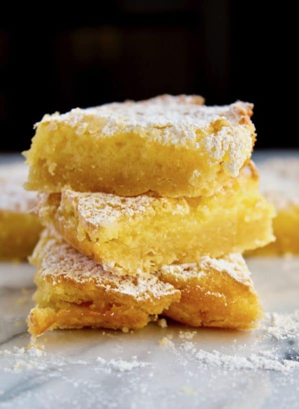 Lemon Squares, three bars stacked on marble board.