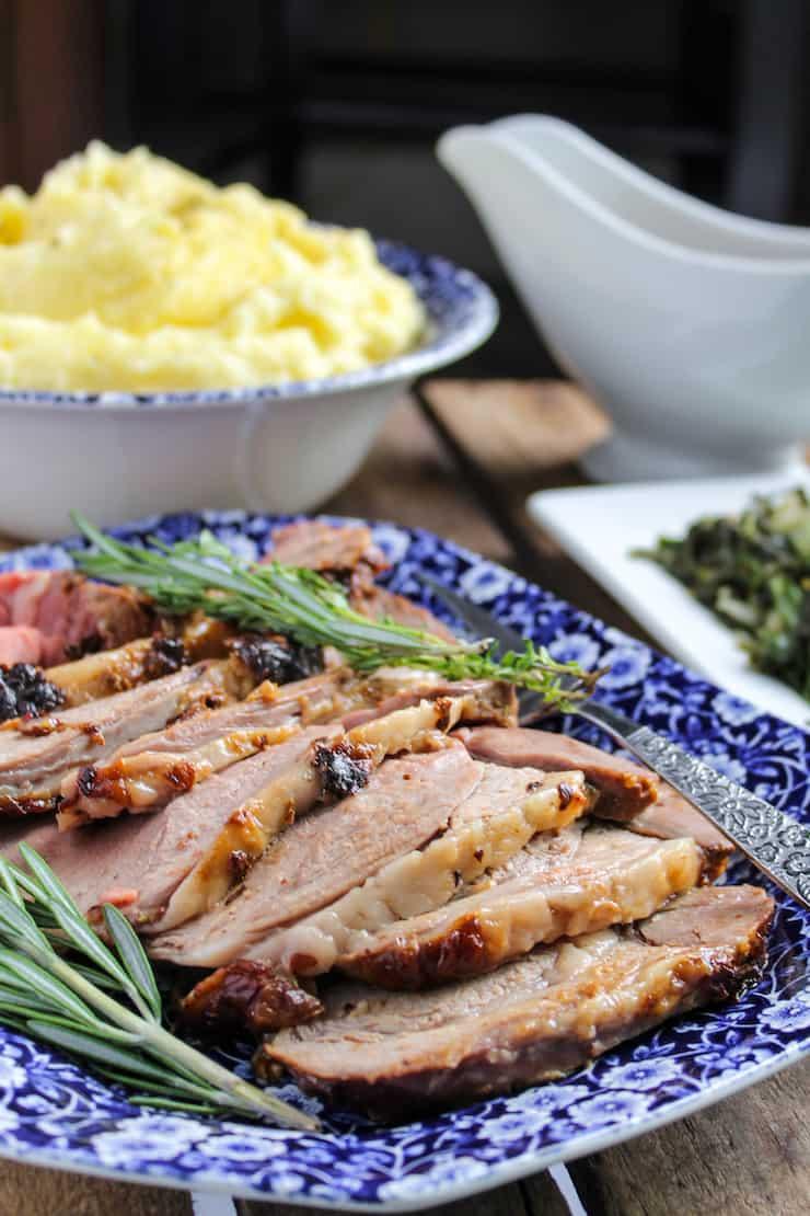 Lamb dinner on platter on table.