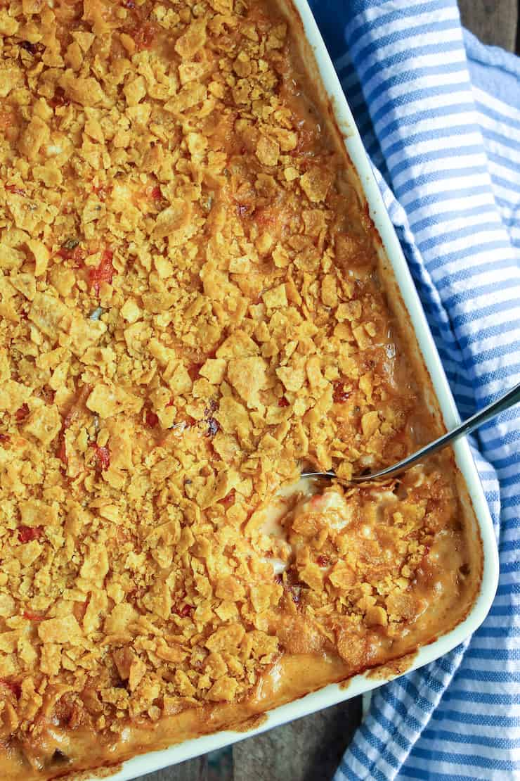 King ranch casserole in baking dish with spoon.