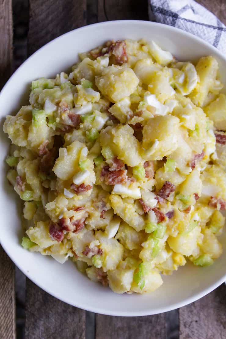 German potato salad in serving bowl.