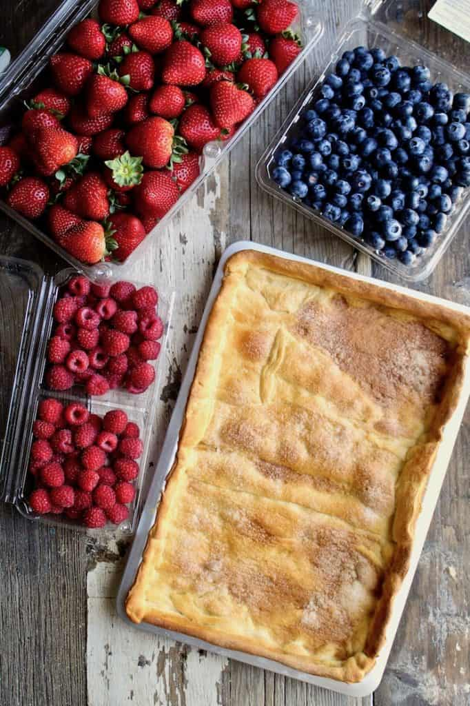 Red, White & Blue Fruit Pizza ingredients, fresh berries and crust in pan.