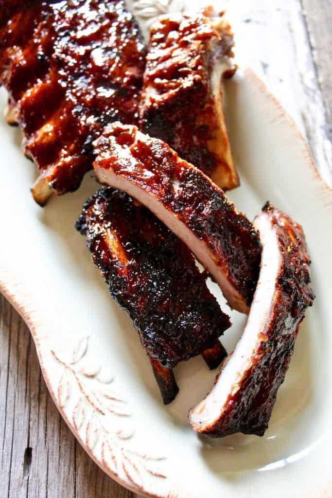 Instant Pot Barbecue Ribs, finished and a few sections cut on serving platter
