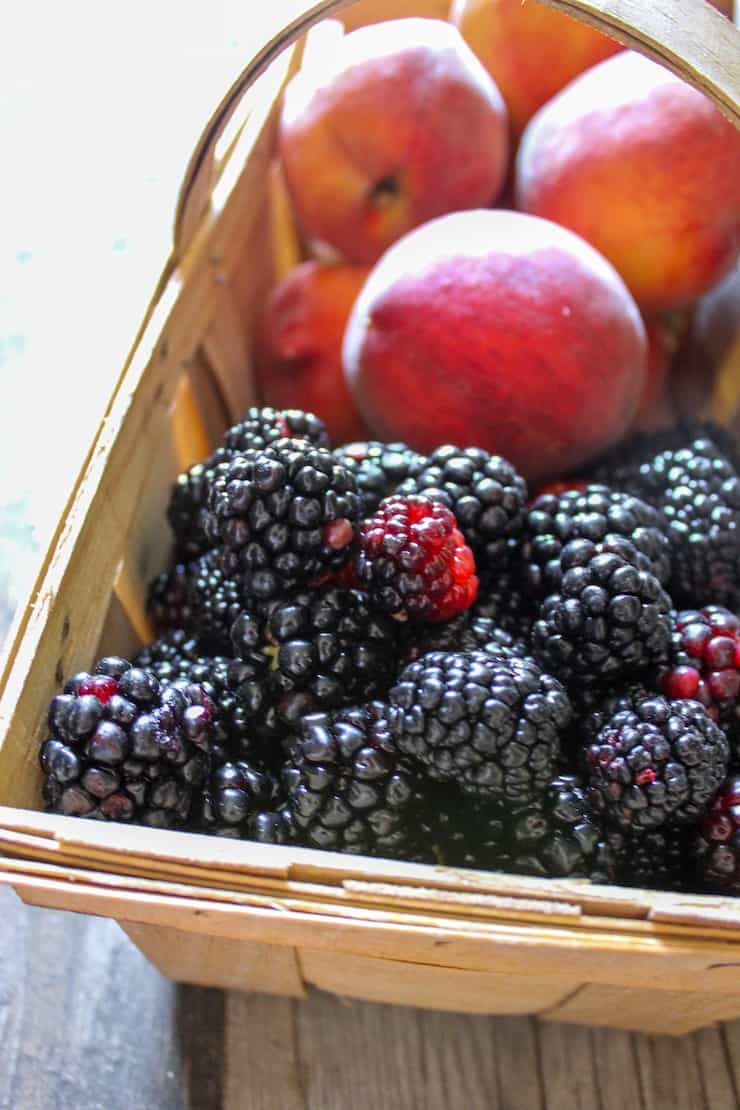 Basket of blackberries and peaches.