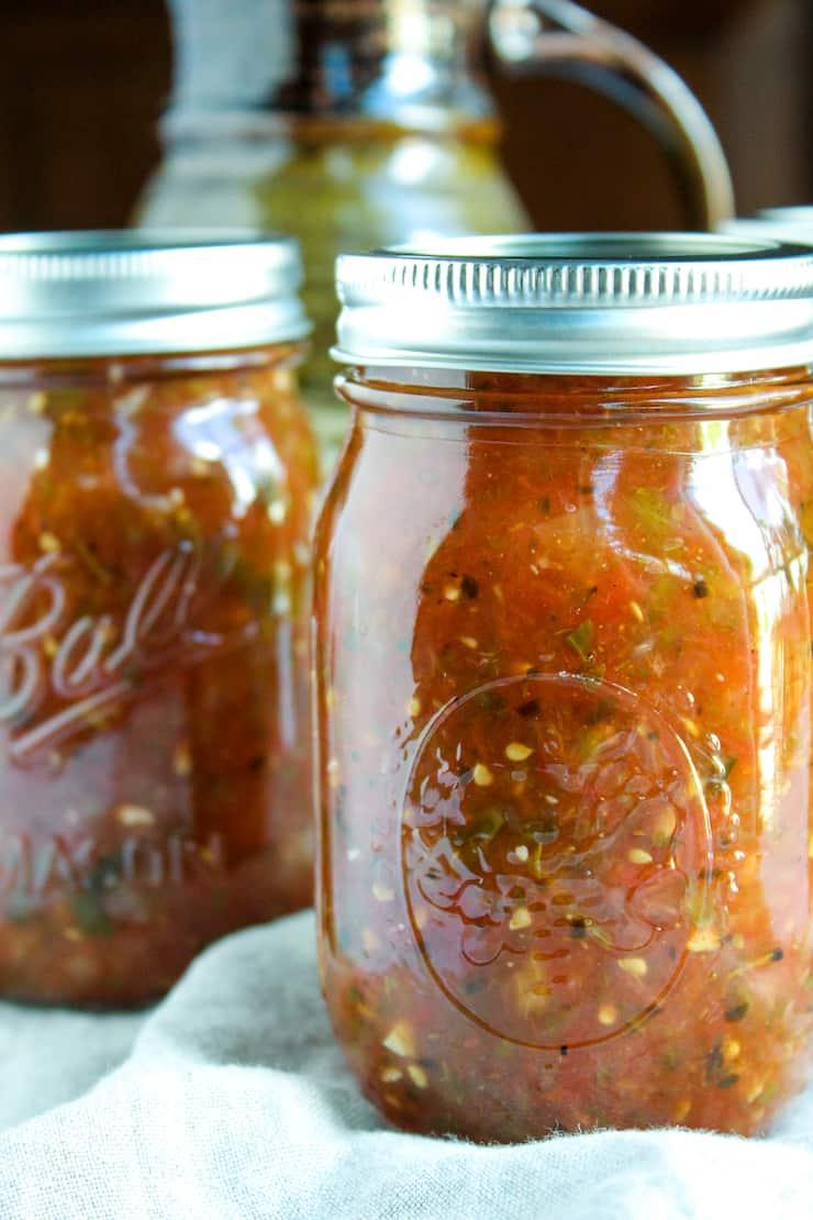 Up close jars of fire roasted salsa.