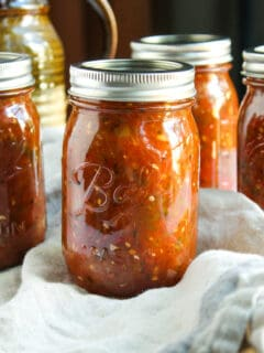 Jars of canned fire roasted salsa.