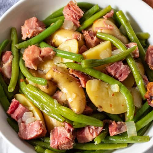 Country green beans and potztoes in serving bowl.