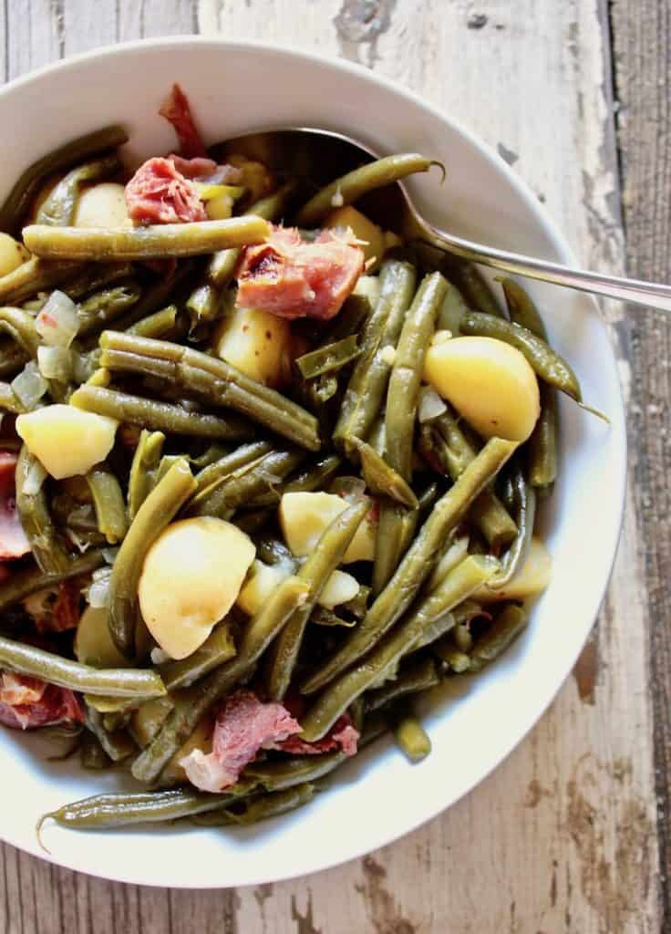 Country Style Green Beans, Potatoes and Ham in the Instant Pot in serving bowl with spoon