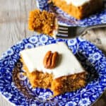 Pumpkin bar on blue plate with piece on fork.