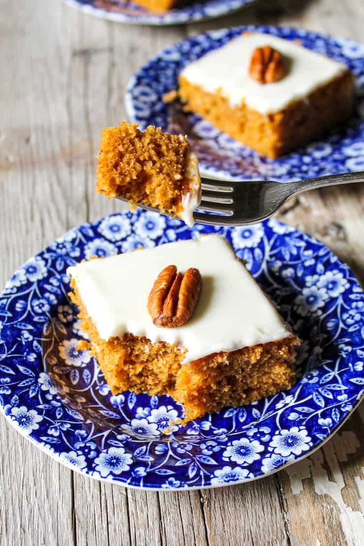 Pumpkin bar on blue plate with bite on fork.