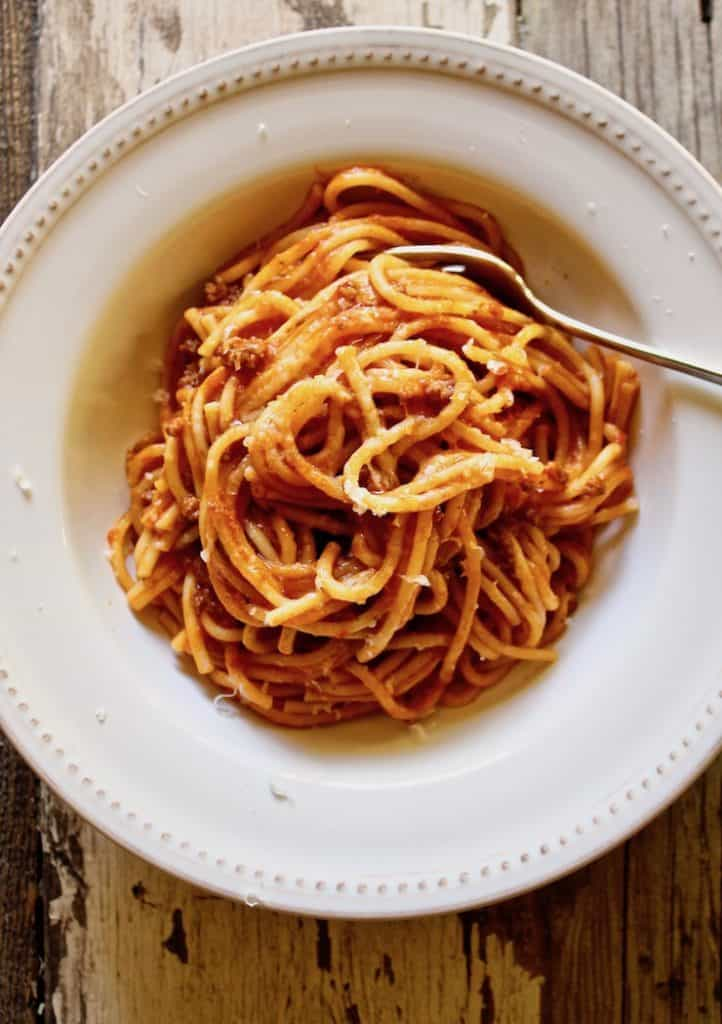 Instant Pot Spaghetti with Meat Sauce, overhead photo of finished spaghetti in serving bowl with fork.