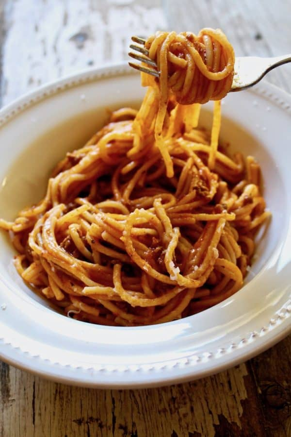 Instant Pot Spaghetti with Meat Sauce, in bowl with forkful of spaghetti