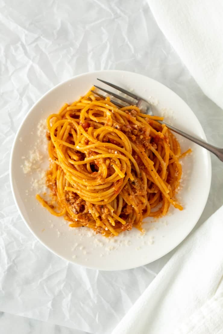 Overhead of spaghetti on white plate