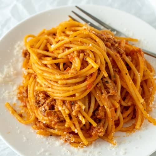 Spaghetti swirled on white serving plate