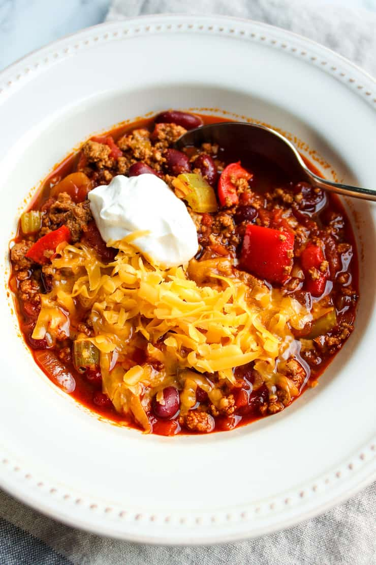 Turkey chili in serving bowl with toppings.