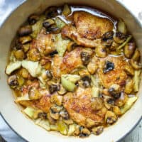 Overhead photo of chicken and artichokes with sherry mushroom sauce.