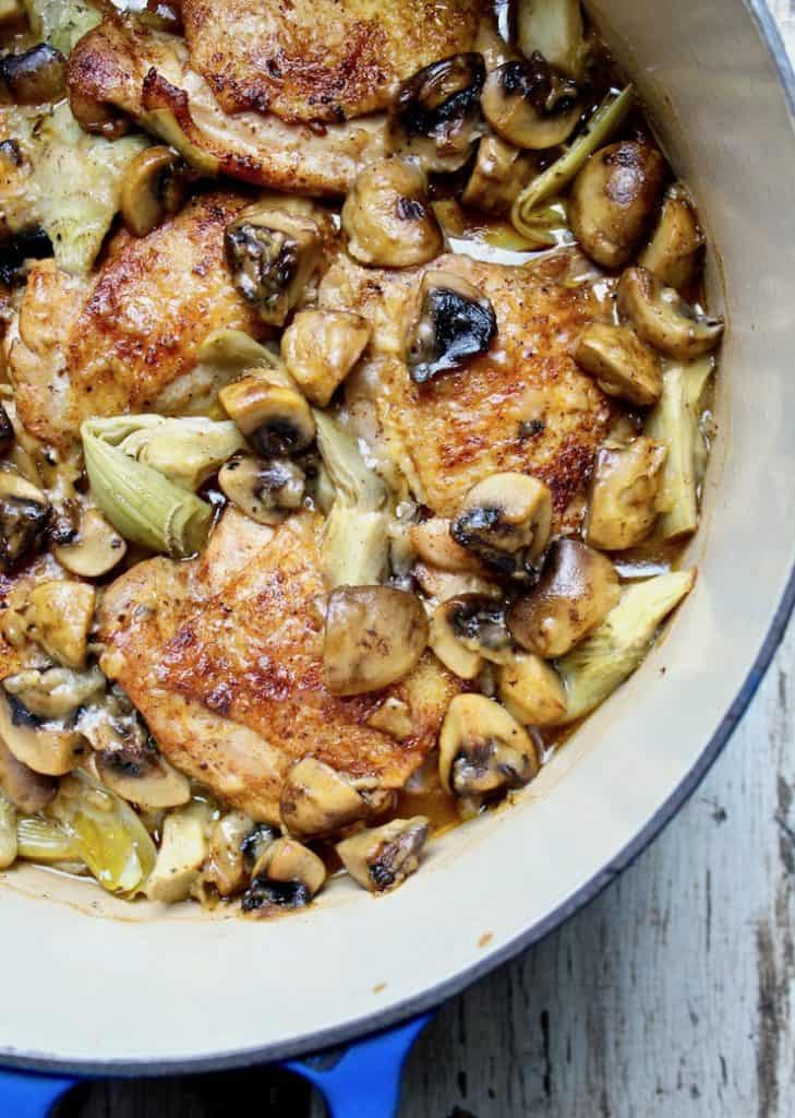 Braised Chicken with Artichokes in Mushroom-Sherry Sauce, close up in pot