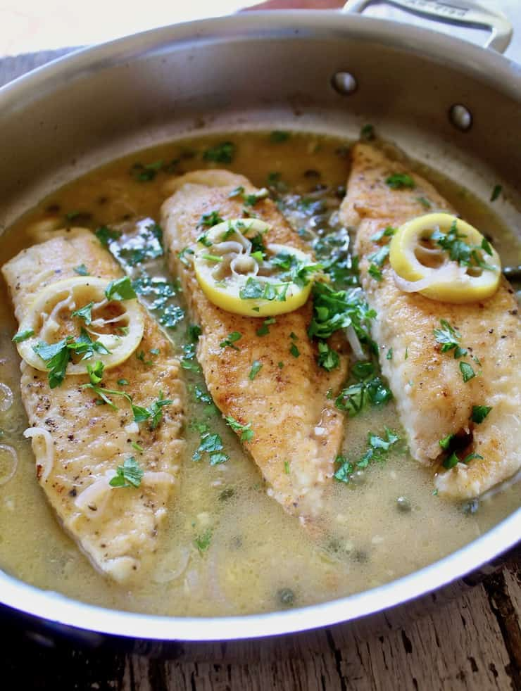 Tilapia piccata in pan with lemons