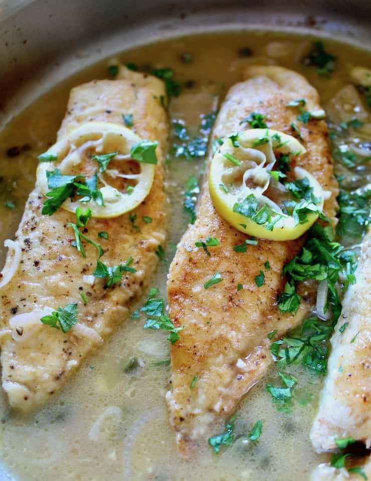 Tilapia Piccata close up in pan