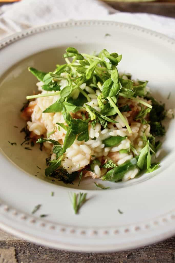 Finished risotto in bowl with fresh herbs.