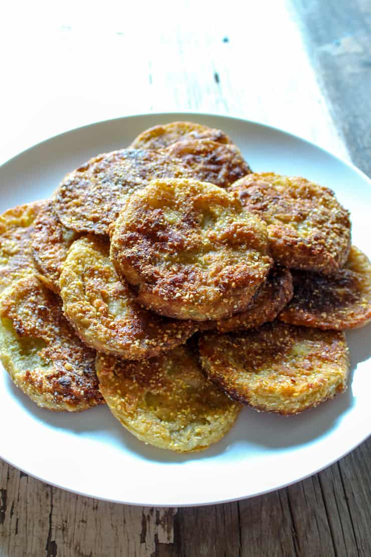 Fried green tomatoes on white plate.