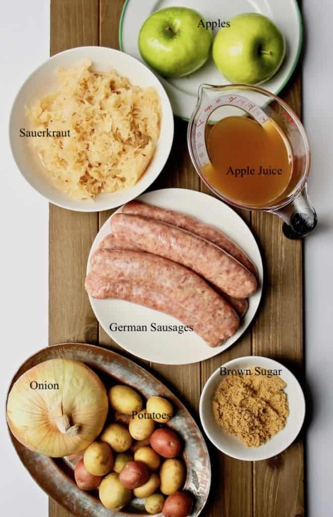 Sausage, Apple, Sauerkraut and Potato Skillet, ingredients on board labeled with text.