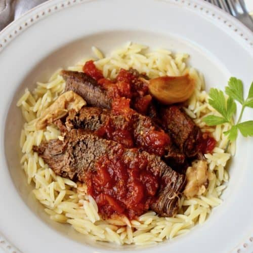 Easy Pot Roast with Tomatoes and Garlic, in serving bowl over orzo