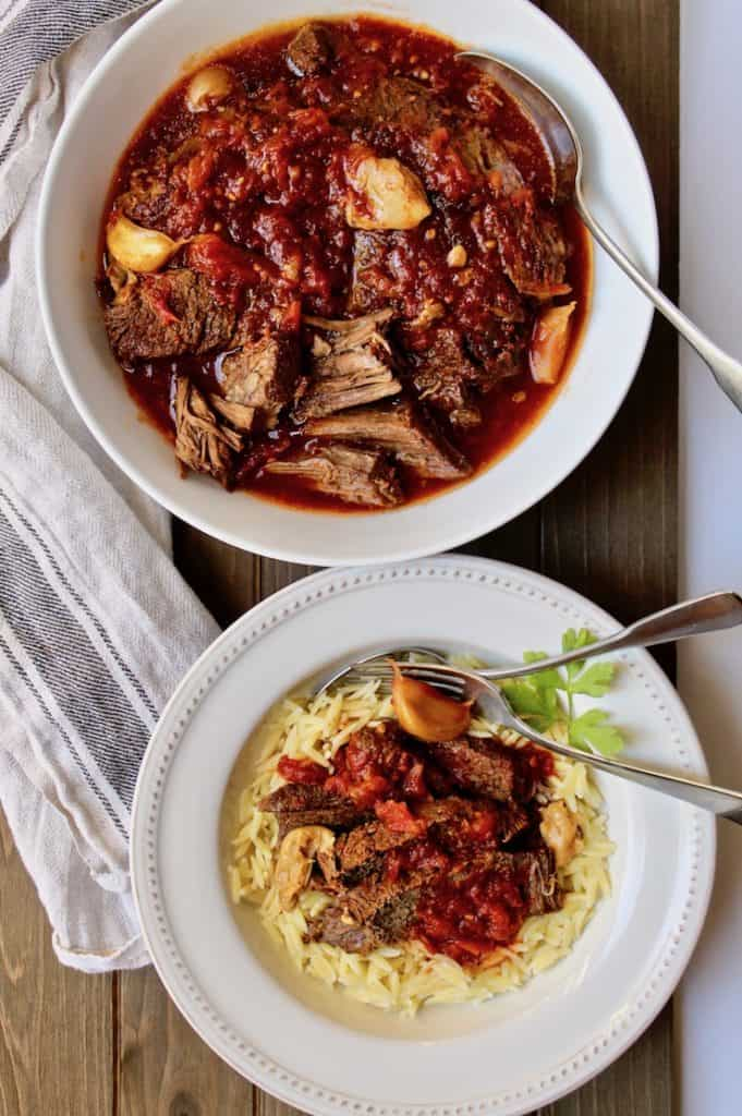 Easy Pot Roast with Tomatoes and Garlic, overhead photo in large serving bowl and in smaller bowl over orzo.