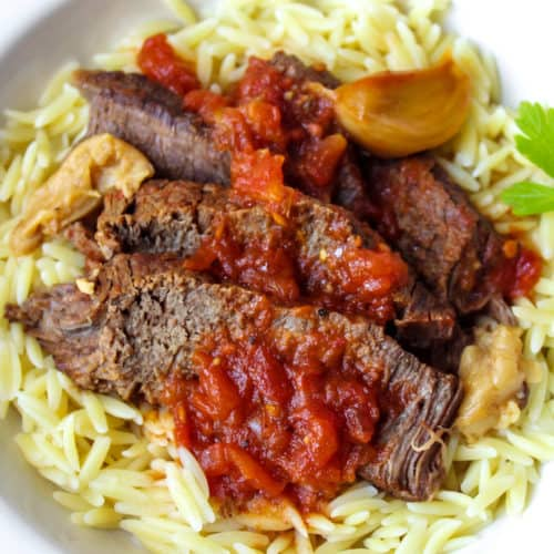 Pot roast served over orzo pasta.