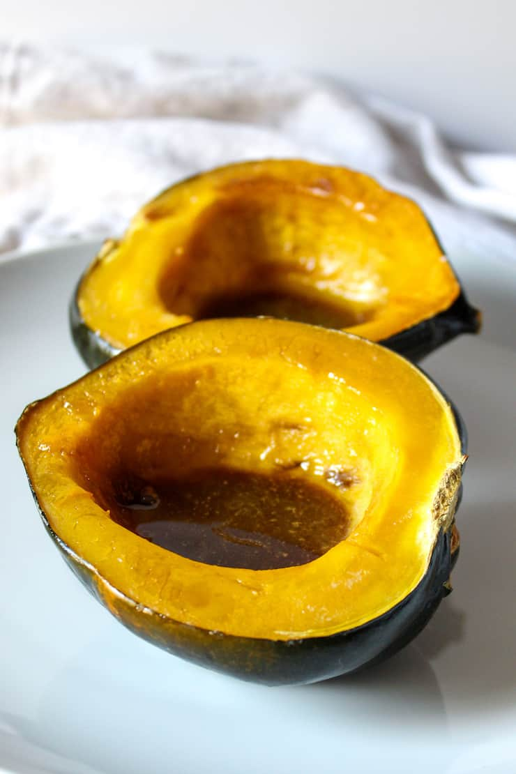 Baked squash with butter and brown sugar in cavity.
