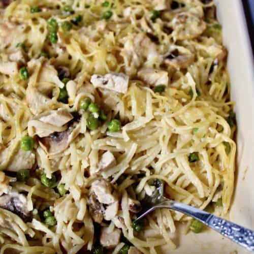 Turkey Tetrazzini, in casserole with serving fork in corner