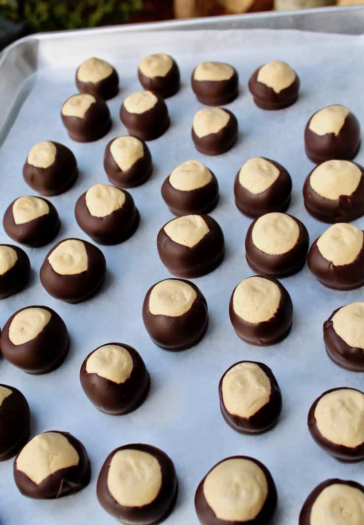 Classic Buckeyes, dipped in choclate on tray lined with waxed paper
