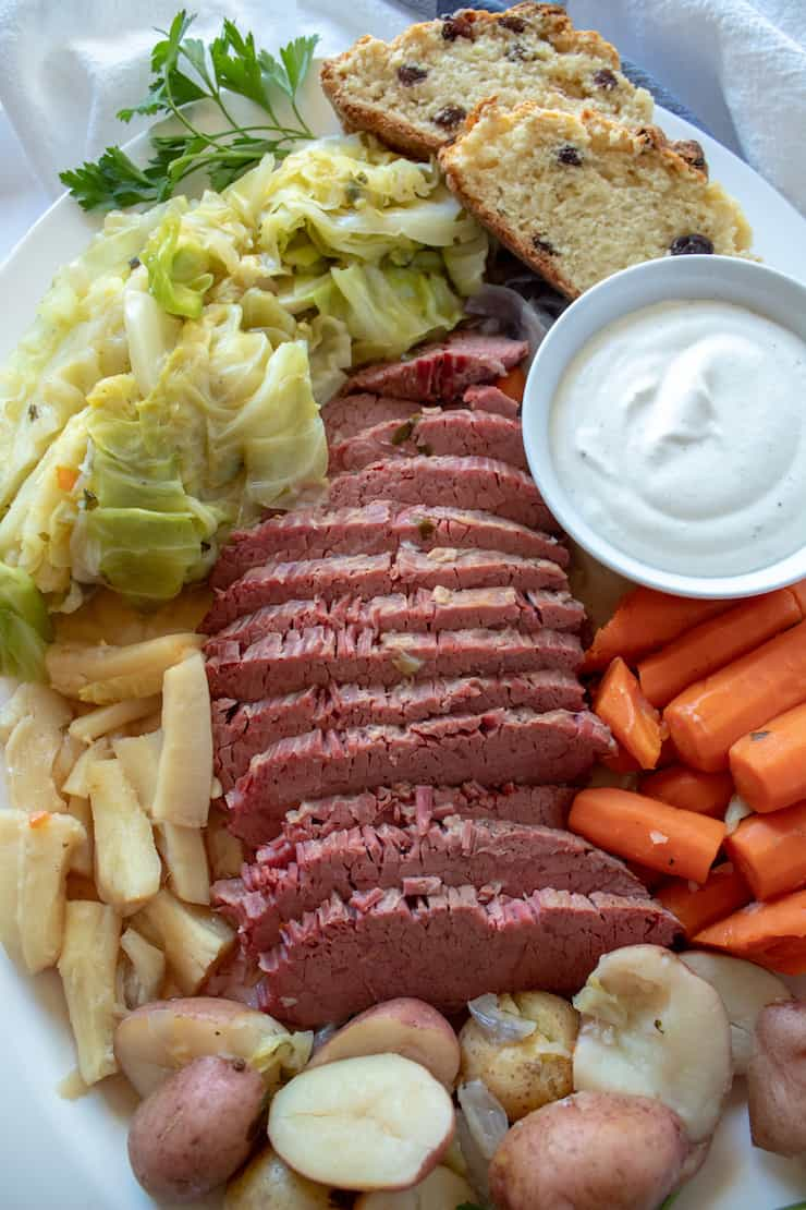 Instant Pot Corned Beef and Cabbage, platter of corned beef, vegetables and cabbage
