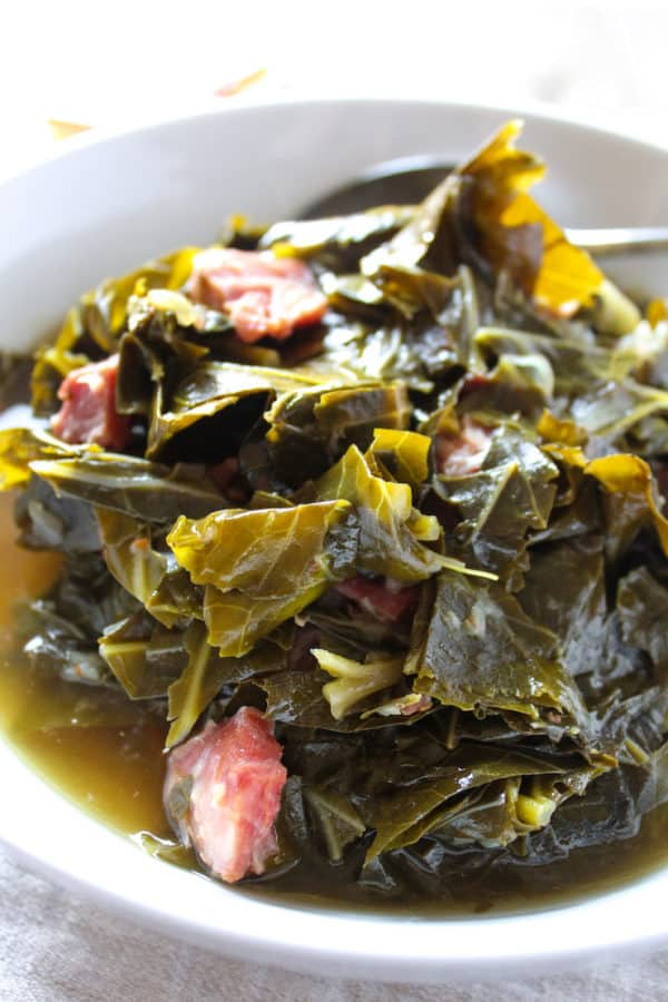 Collards in white serving bowl.