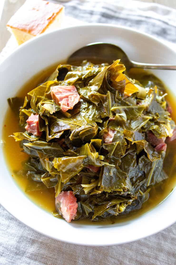 Instant Pot collards with pot liquor in serving bowl.