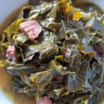 Instant Pot Collard Greens, close up in serving bowl with spoon.