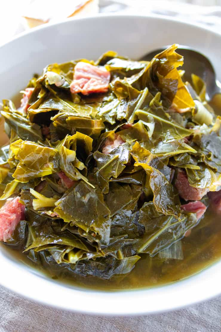 Instant Pot collard greens in white serving bowl.
