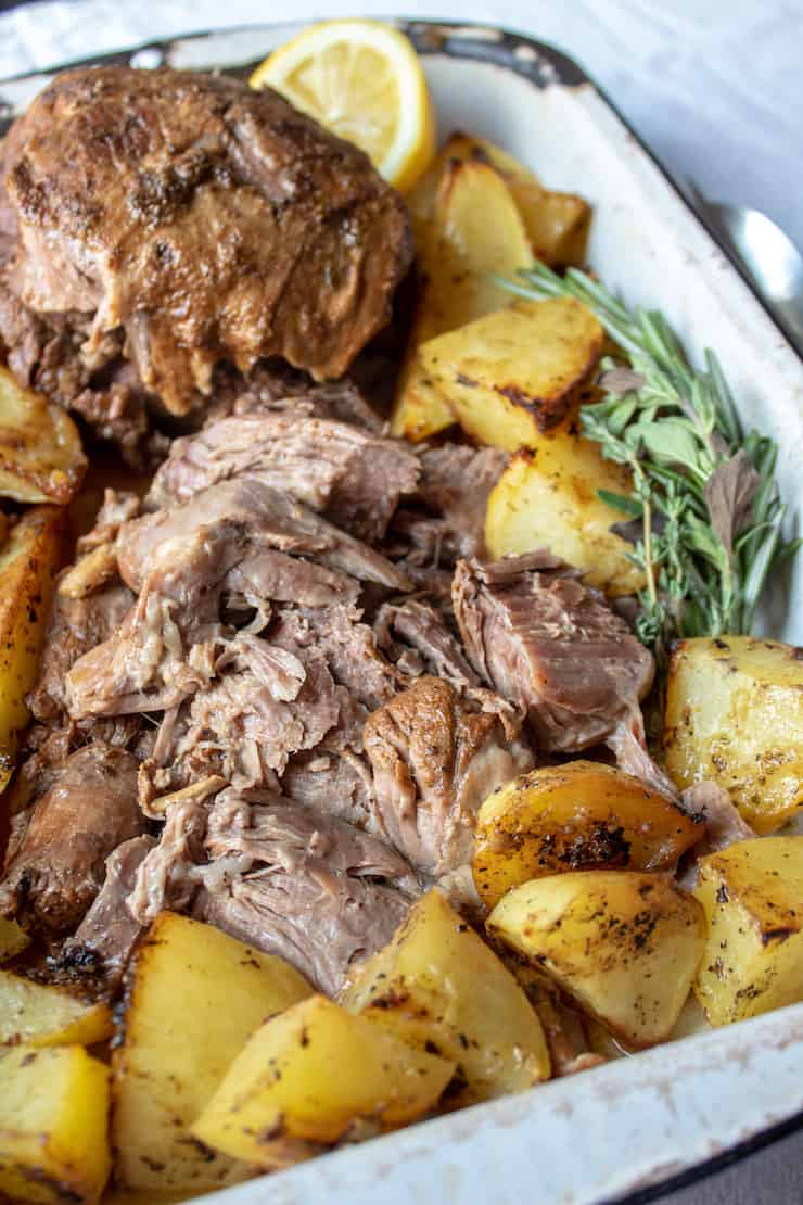 Greek Instant Pot Leg of Lamb, closeup inpan with potatoes.