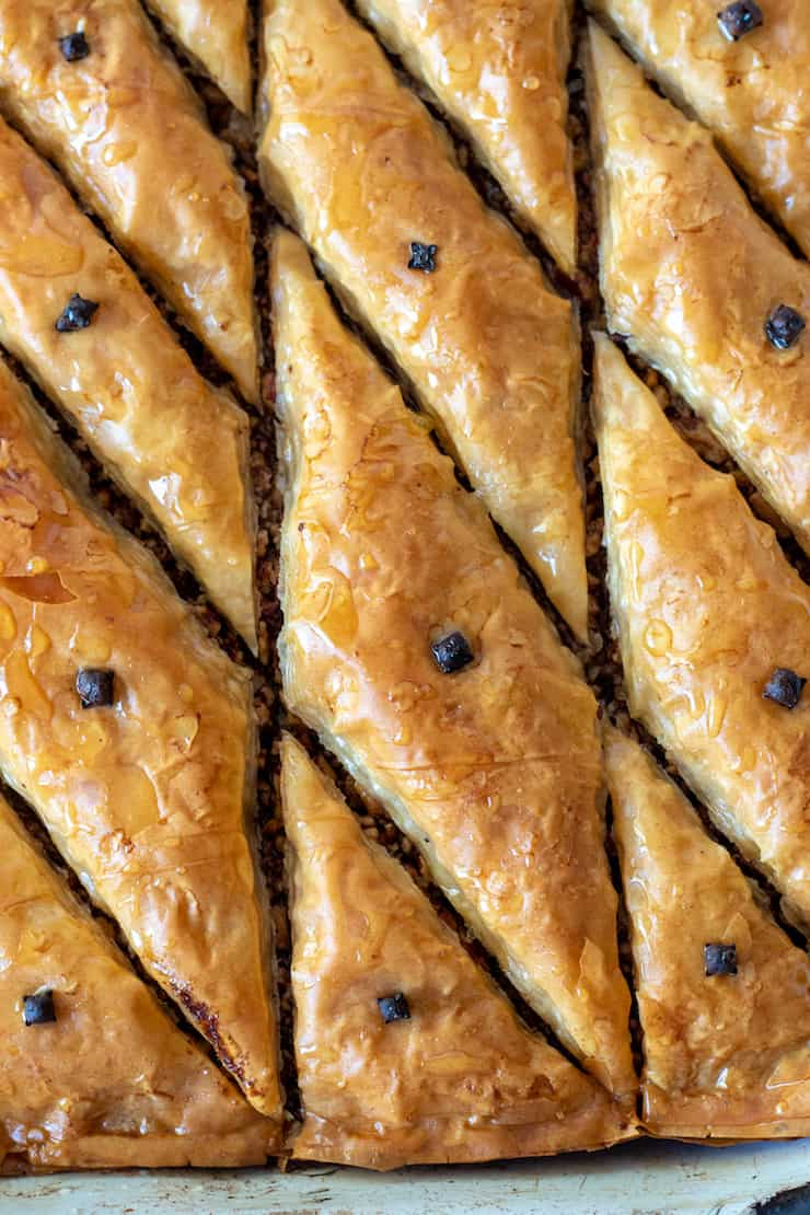 Closeup of baked baklava in pan.