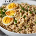Pin for Pinterest with text, in serving bowl with hardboiled egg garnish.