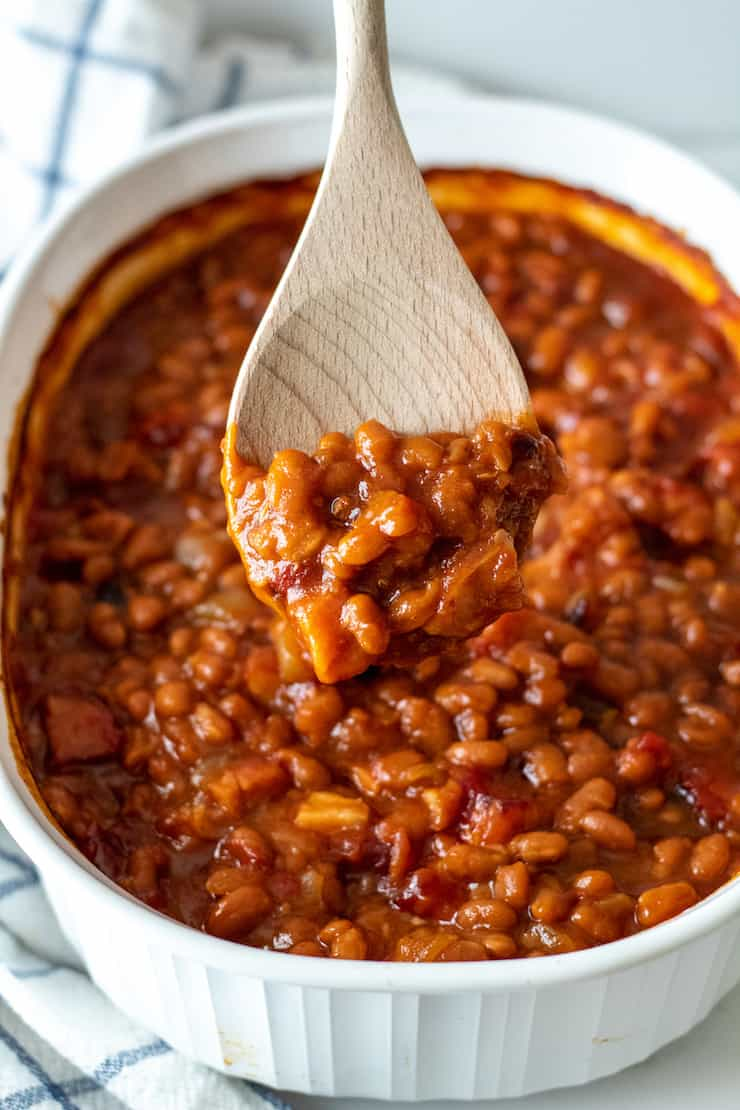 Close up of spoonful of baked beans.