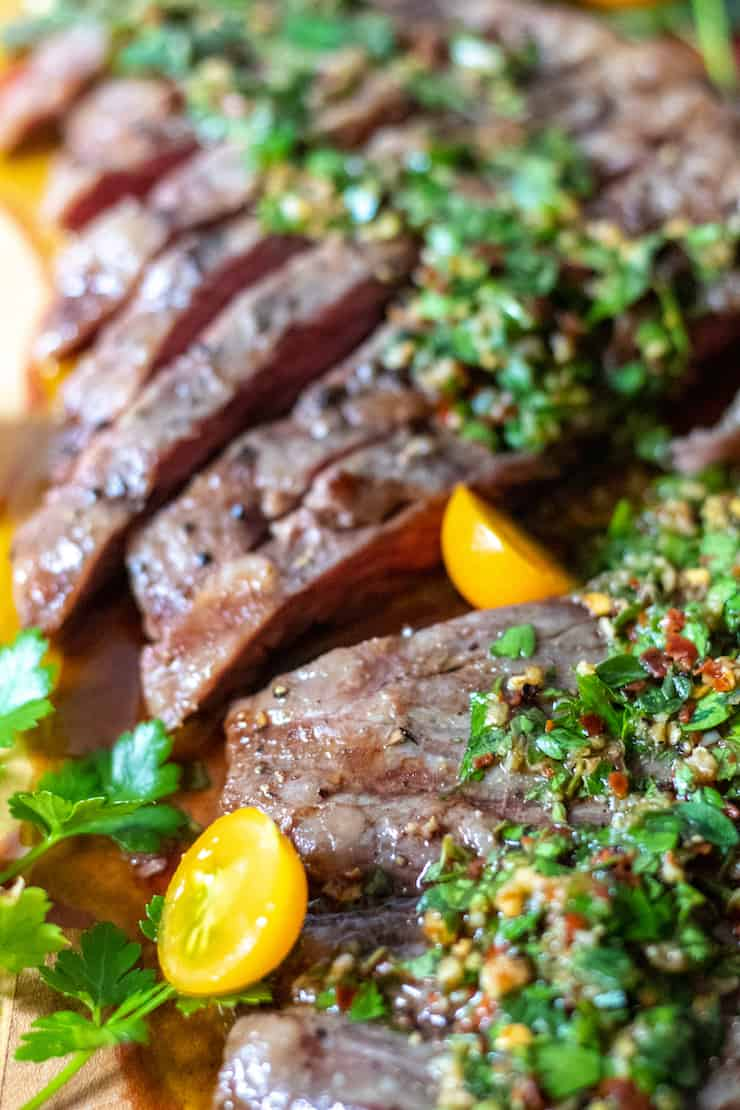 Sliced grilled steak with chimichurri