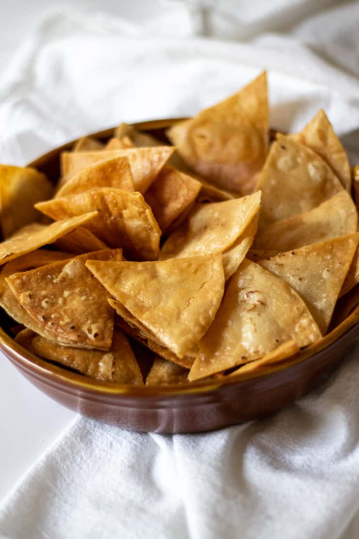 Homemade tortilla chips in bowl.