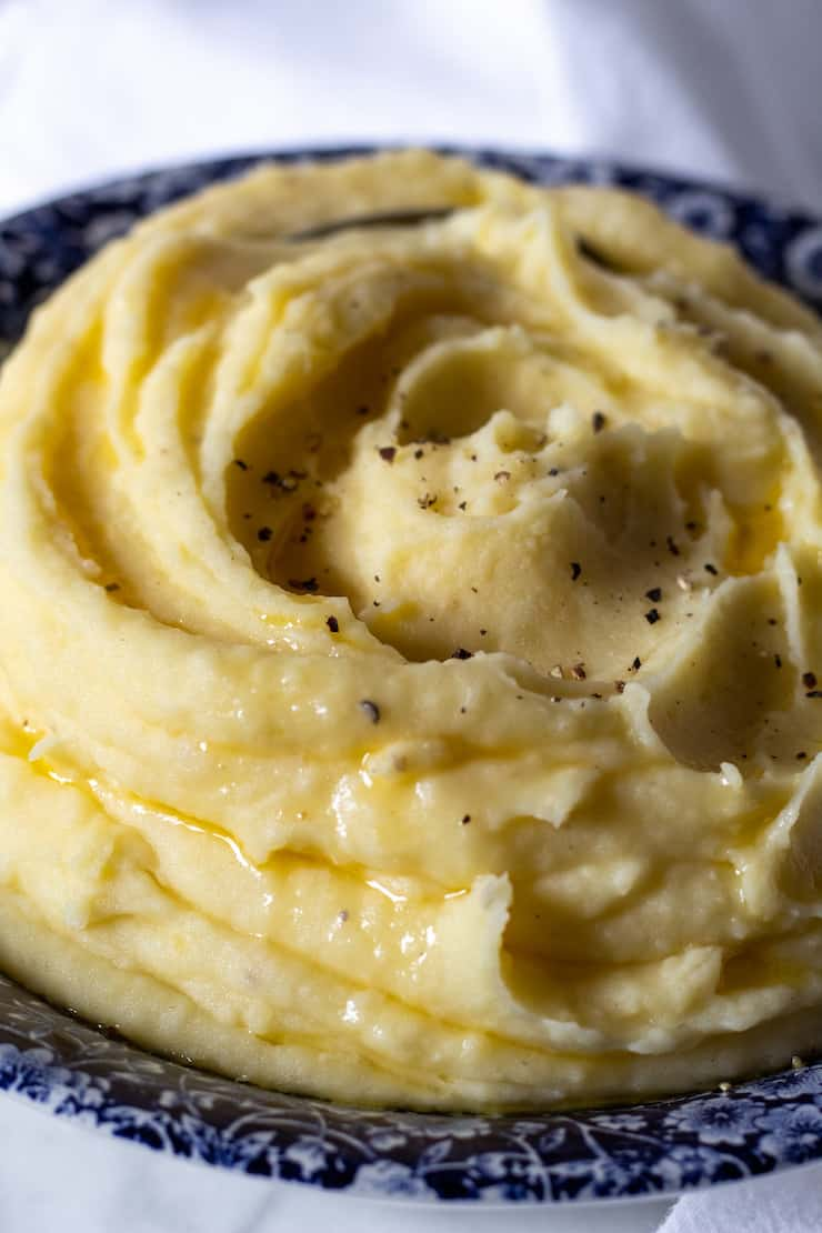 Garlic buttermilk mashed potatoes in blue serving bowl.