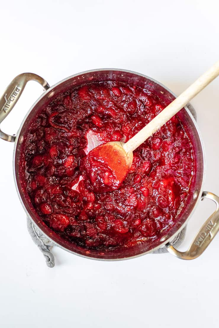Cranberry sauce thickened in saucepan.