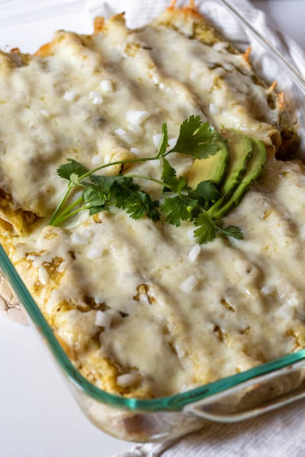 Pan of baked enchiladas suizas.