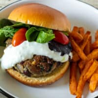 Greek turkey burger with yogaurt sauce and sweet potatoe fries.