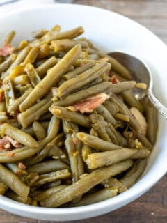 Finishe green beans in serving bowl.