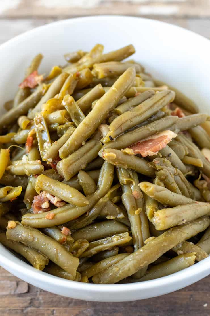 Southern style green beans in white bowl.