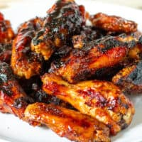 Maple bourbon grilled chicken wings on a serving plate.